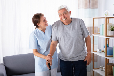 caregiver and snior man smiling