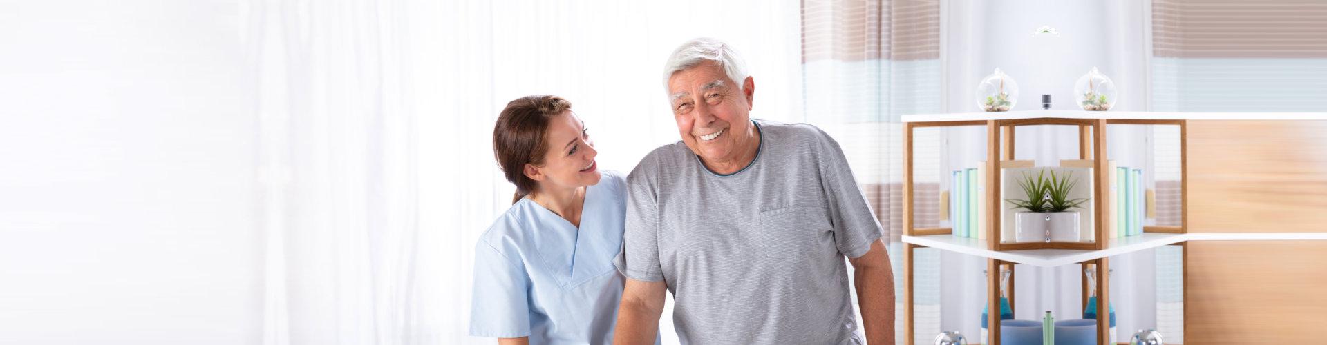 caregiver and snior man smiling